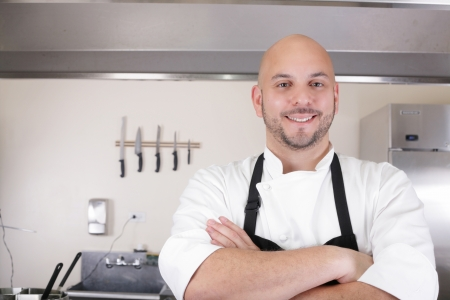 Portrait of a professional chef smiling photo