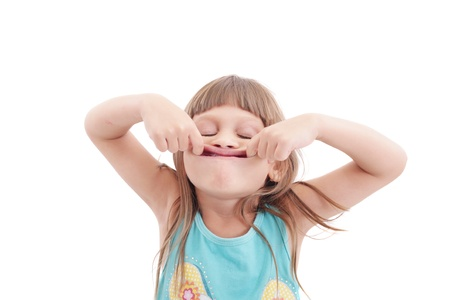 making a face: Little girl making funny face, isolated on white