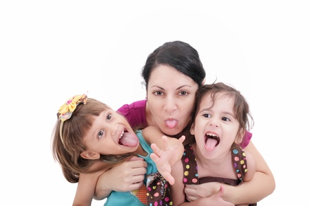 making fun: Mother and two daughter pulling funny faces at camera