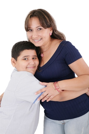 Happy young mother and her son posing together. Isolated over white.  photo