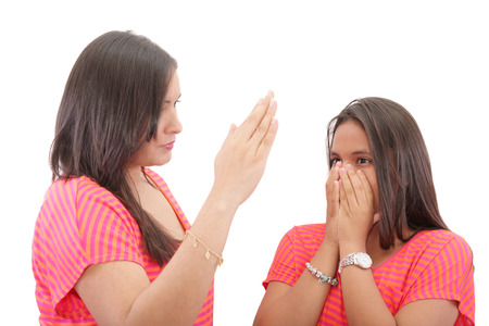 slap: mother preparing to slap her daughter in the face Stock Photo