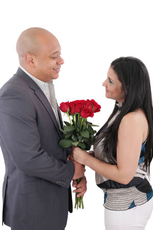 Happy couple holding a bouquet of red roses photo