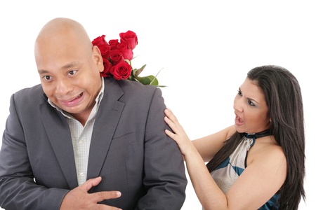 hysterics: Woman hut his boyfriend with a bouquet of red roses Stock Photo