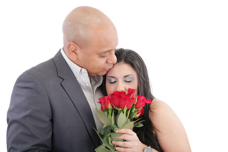 woman enjoys the smell given of a bouquet of roses photo