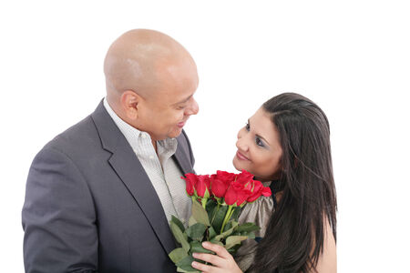 man giving a bouquet of red roses to his pretty girlfriend photo