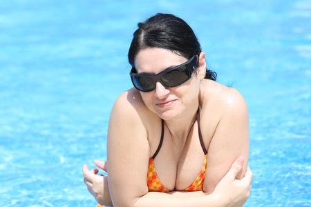 women bathing: Gorgeous woman in the pool Stock Photo