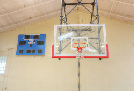 Basketball hoop cage with score table photo