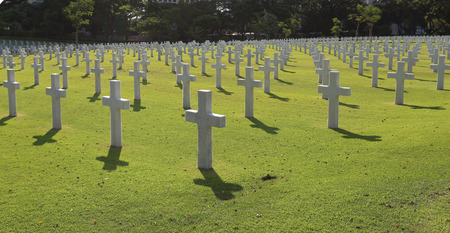 national military cemetery: Many Marble Crosses on a Cemetery Stock Photo