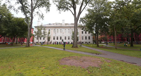 rankings: Boston, USA - Sept 9, 2016: University Hall and John Harvard Monument in the campus of Harvard University in Sept. 9 on 2016 in Boston, USA.  Regarding rankings of specific indicators, Harvard topped both University Ranking by Academic Performance 2015-20