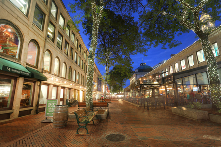 BOSTON, USA - SEPT. 9: The open spaces of Quincy Market are a common venue for various street performers and restaurants. Taken at twilight on Sept 9, 2016 in Boston, USA.