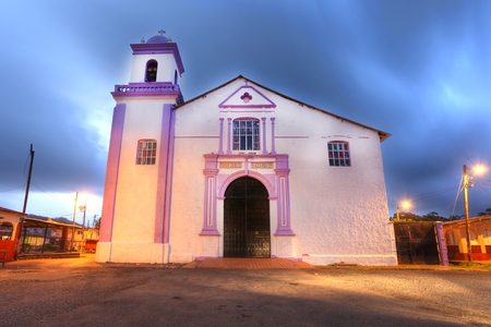 PORTOBELO, PANAMA - APR 15: The large white church at Portobelo is the Iglesia de San Felipe, which is still in use. It dates from 1814, but its tower wasn't completed until 1945. It's famous as the home of the life-sized effigy of the Nazareno of Por