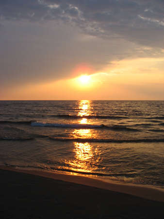 a seascape with the sunset