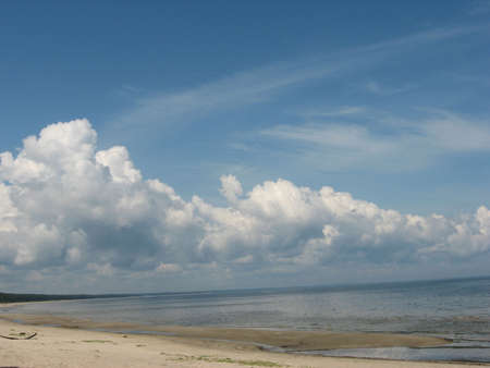 a seascape with the cloudy sky photo