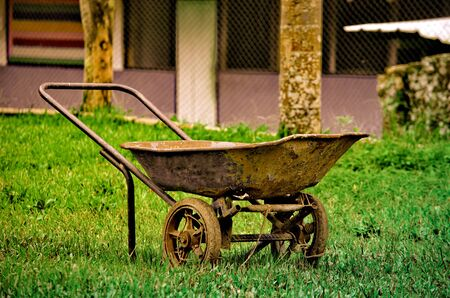Very old cement trolley Note on the lawn
