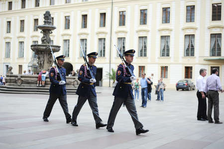 Soldiers go a march on the area in Prague