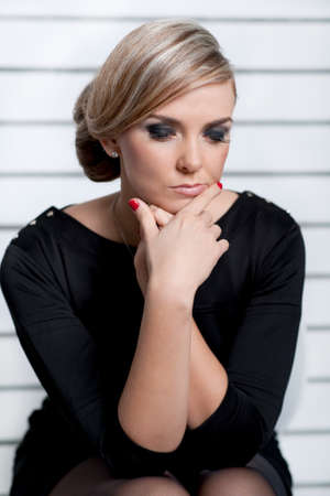 an attractive young woman looking up with a contemplative expression.