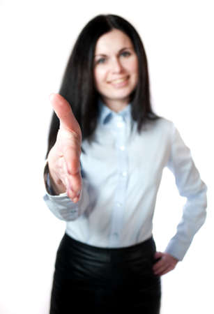Busnesswoman going to shake your hand. Shallow depth of field, focus on finger-tips. isolated on the white photo