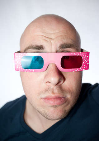 spectator: Spectator on a 3D movie with paper glasses on