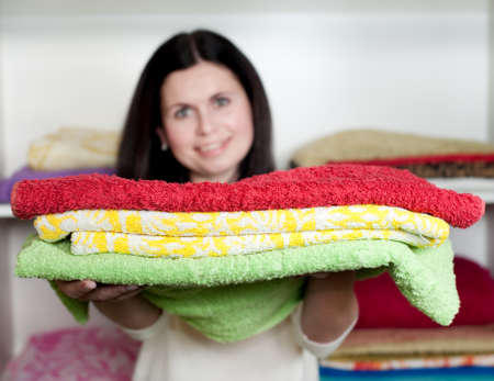 the girl holds pure towels photo