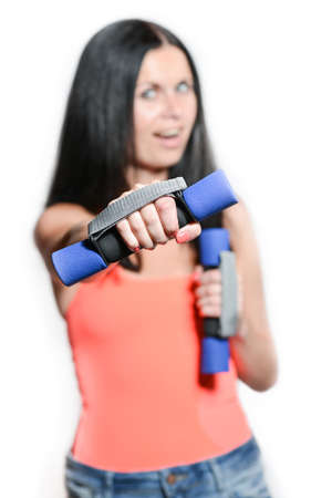 fitness woman. Fit fitness girl smiling happy lifting weights. fitness model isolated on white background Stock Photo