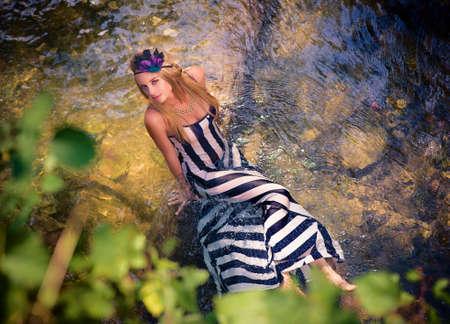 beautiful fantastic girl lies in the lake