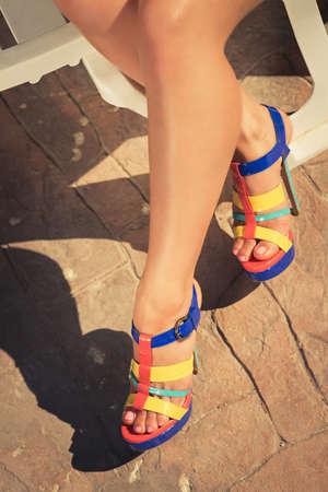 Woman feet with high-heel shoes walking.  pool photo