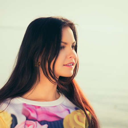 Young and beautiful woman in sunset light. lengthiest, beautiful hair.