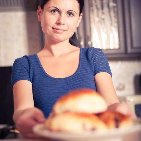 munching: young woman prepared cherry pies, bon appetit Stock Photo
