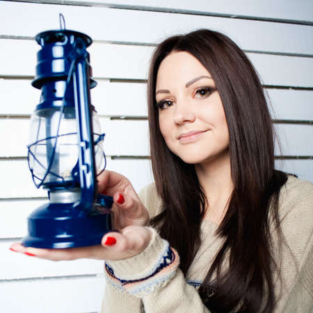 the beautiful girl with a lamp shines the room Stock Photo