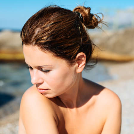 beautiful sunny portrait of a young woman enjoying summer sun