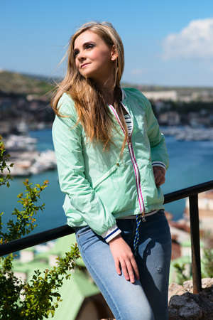 young adult lady enjoying summer travel. European girl tourist traveling in sail boat around the world.