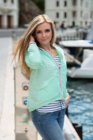 Beautiful woman sailing, young adult lady enjoying summer travel. European girl tourist traveling in sail boat around the world photo