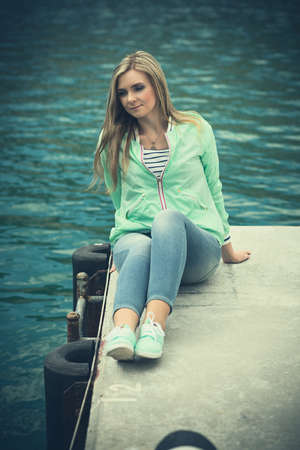 Beautiful woman sailing, young adult lady enjoying summer travel. European girl tourist traveling around the world photo
