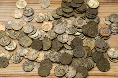 5 10: Old soviet couns on a wooden background. Hisoric, used currency.