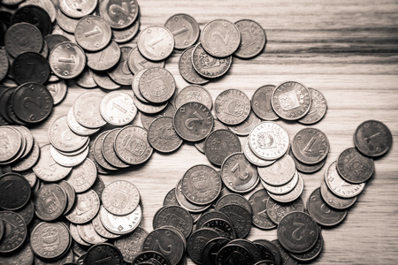 Old Latvian coins on a wooden backgrouns. Lats and centimes. Stock Photo