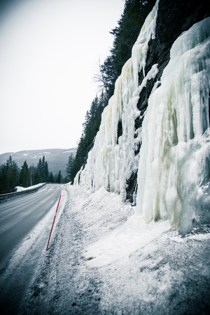 winter road: A beautiful frozen icicles along the road in Norwegian winter