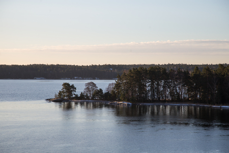 A view from the sea to Sweden archipelago near Stockholm in the winter.