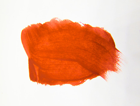 An abstract paint dab in red color on white background. Graphic element.