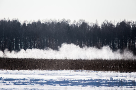 Cars racing on the frozen lake. Drifting cars on ice. Fun sport in winter. Stock Photo