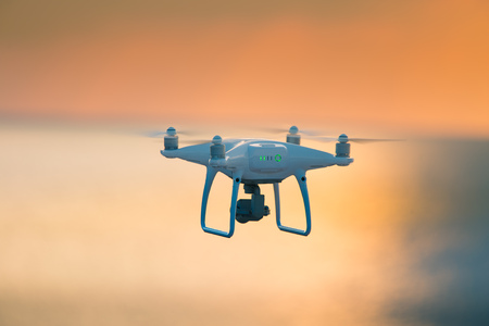 A beautiful flying drone in the evening skies. . Banco de Imagens
