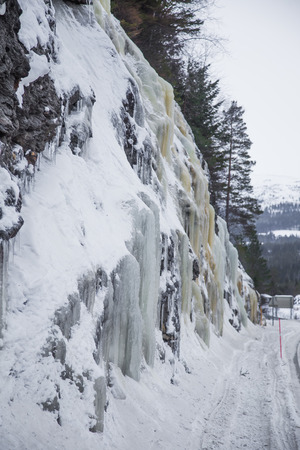 Beautiful frozen icicles on the roadside. Norwegian winter scenery. Beautiful ice structures.