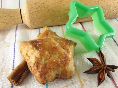 Star shaped cookies, spices and cookie cutters photo