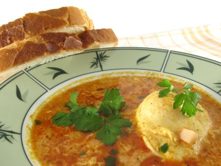 fresh soup in a bowl garnished with parsley photo