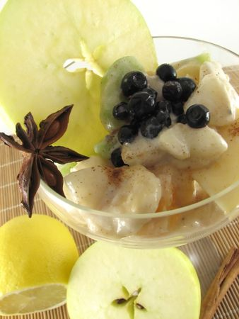 close up view of fruit salad on wite background photo
