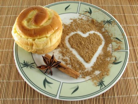 cookie with a heart drawn with cinnamon powder photo