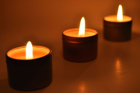 Close up of a burning candles in the night photo