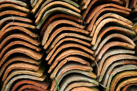 close up of a pile of old roof tiles