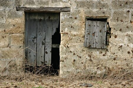 Old door and window of ancient french vineyard cabin Stock Photo