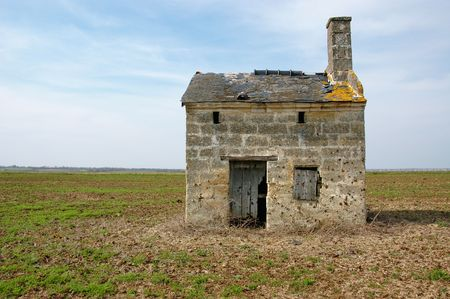 Small old french vineyard cabin standing alone in the middle of an ancient vineyard