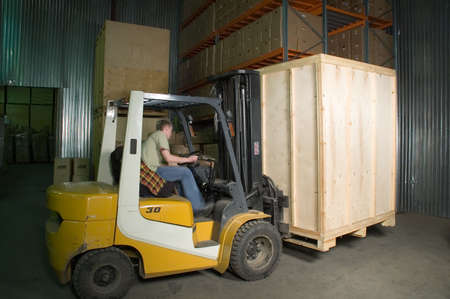 Man working on the truck in the warehouse